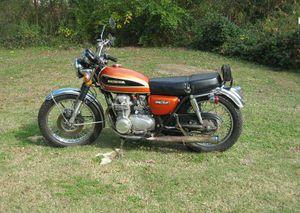 Honda cb550k cyclechaos 1975 honda cb550k in orange publicscrutiny Choice Image